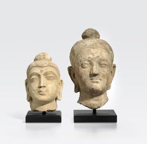 TWO STUCCO HEADS OF BUDDHA Gandhara