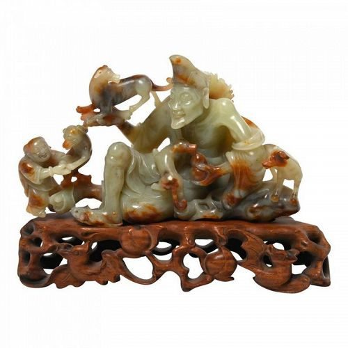 CARVED JADE OF A SEATED IMMORTAL 'JI GONG' ON BASE