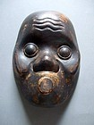 Wood carving positive mold of Hyottoko mask