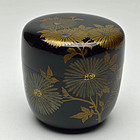 Makie lacquered natsume tea caddy with chrysanthemum design