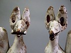 Pair of Japanese coloured Inari fox clay dolls