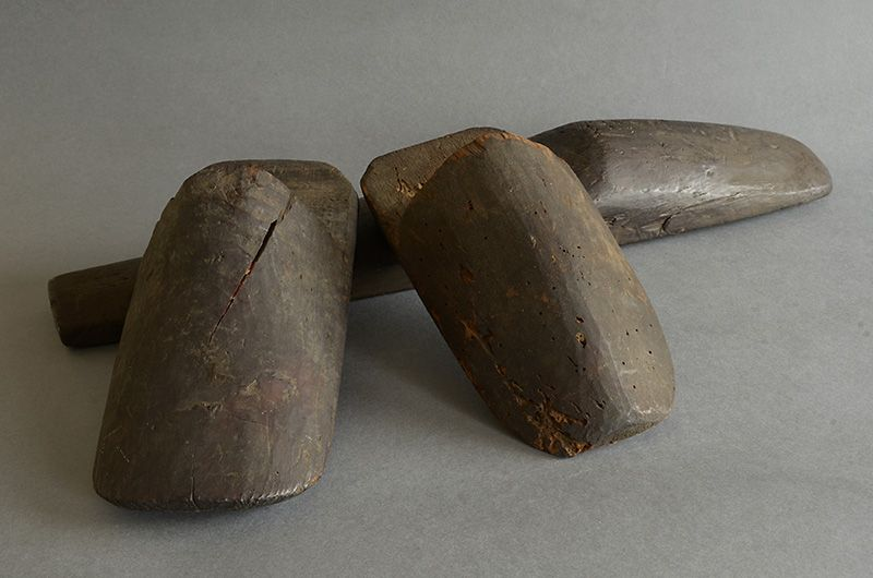 Three wooden lasts of straw boots