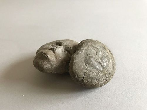 HUMAN-FACED STONES 2pc.