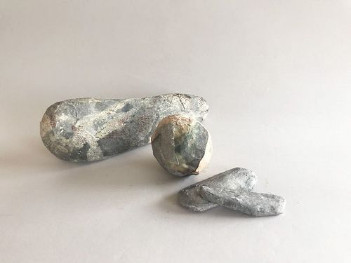 PAPER-MACHE STONE IMPLEMENTS