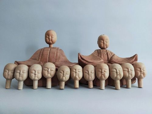 HINA DOLLS AND ELEVEN HEADS