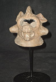 AN ODD AND FASCINATING MAYA POTTERY HELMETED MASK