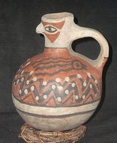 A HIGHLY ORNAMENTED HUARI HANDLED JAR FROM PERU