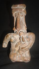 A WHIMSICAL COLIMA FIGURE OF A MOTHER AND CHILD