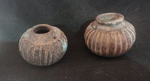 A PAIR OF CLOSELY MATCHED MAYA SQUASH SHAPED POISON JARS