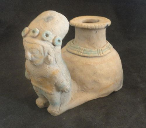 AN ORNATELY ATTIRED  JAMA-COAQUE SHAMAN SNUFF JAR FROM ECUADOR