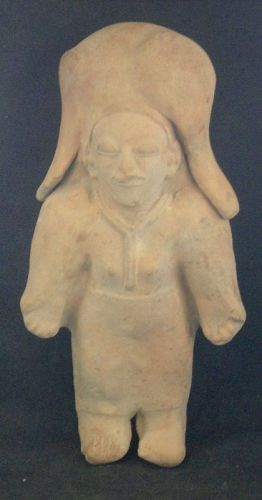 A SUPERB STANDING JAMA-COAQUE FEMALE SHAMAN EFFIGY FROM ECUADOR