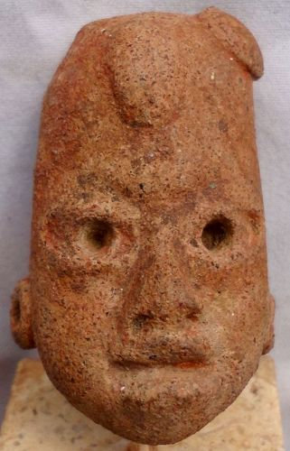 A TRULY SUPERB ARCHAIC OLMECOID STYLE HEAD FRAGMENT