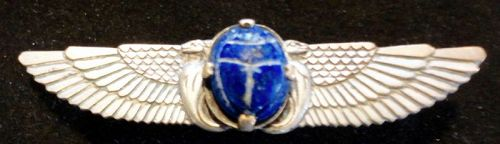 AN ELEGANT ART DECO EGYPTIAN REVIVAL WINGED SCARAB BROACH
