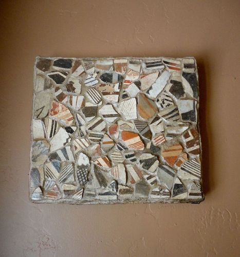 A CAREFULLY CONSTRUCTED WALL PLAQUE OF MIMBRES SHERDS