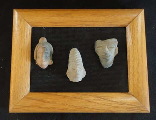 THREE UNUSUAL PRE-COLUMBIAN POTTERY HEADS MOUNTED FOR DISPLAY