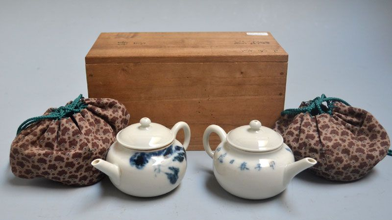 A pair of Kutani Kyusu Tea Pots decorated by Kai Kozan