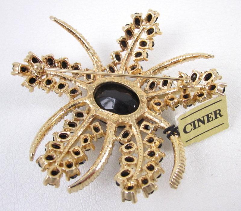 Striking Ciner Black & Clear Crystal Pin