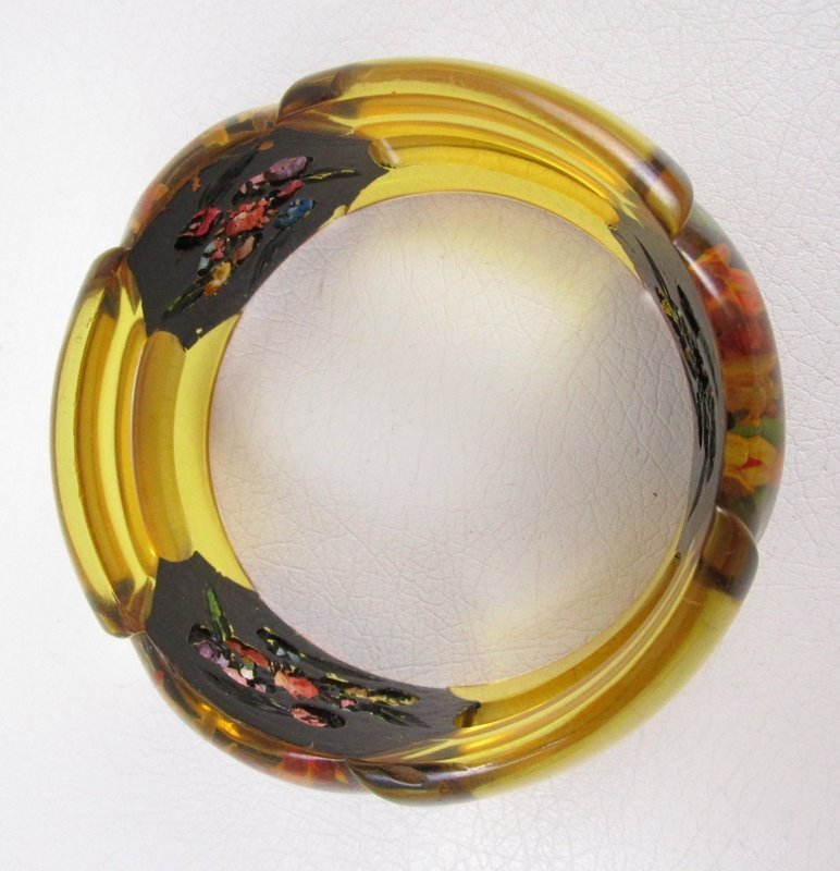 Outstanding Applejuice Bakelite Reverse Carved Floral Bracelet