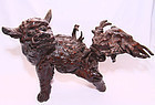 chinai old snarling qilin root carving