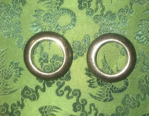 One pair of silver wedding rings