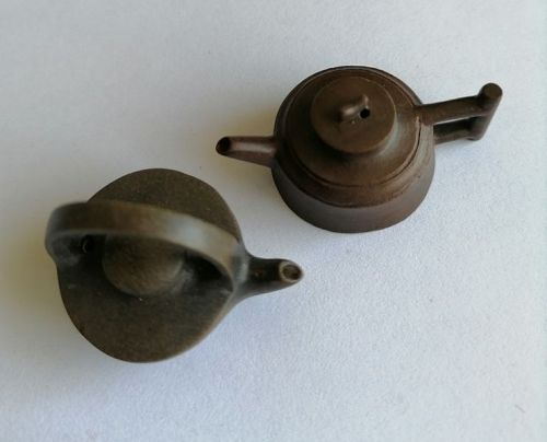 China. Two tiny teapots.