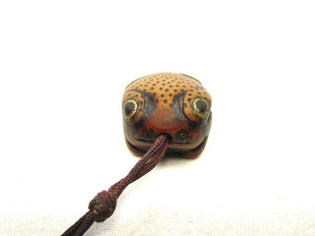 China. Toggle.  Small frog.