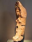 a miniature votive sarcophage