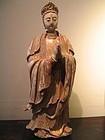 a stucco figure of an apsara