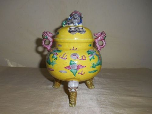 A YELLOW-GROUND FAMILLE ROSE TRIPOD CENSER