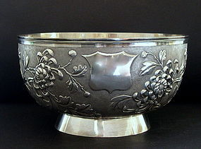 Chinese silver bowl by yok sang and flowers embossed