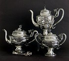 Chinese silver tea and coffee set with dragon decor