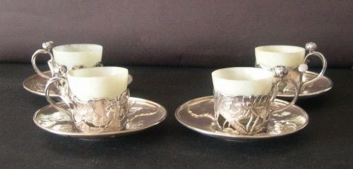 Japanese silver cup holders and saucers with jade cups
