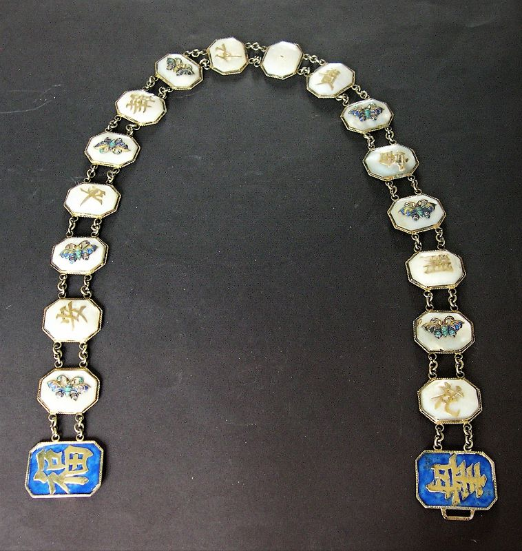 Chinese belt of mother of pearl discs with silver and enamel mounts