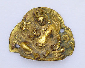 A Sino-Tibetan Gilt Bronze Seated Jambhala