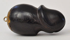 A Thai Wood-Carved Lingam