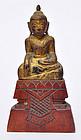 A Thai Gilt Wood Carved Buddha