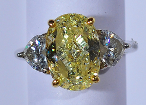 A 4.11 ct Fancy Yellow Natural Diamond Ring