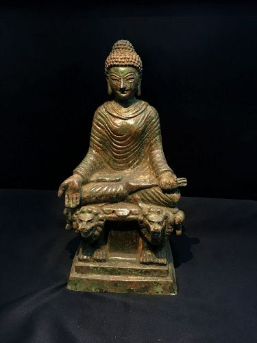 A highly important and rare bronze seated figure of Buddha