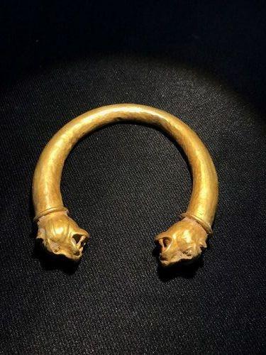 A gold bracelet with lion head