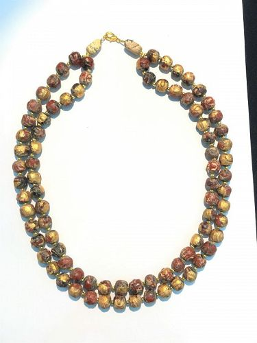 A beautiful necklace of hard clay beads with Buddha painted