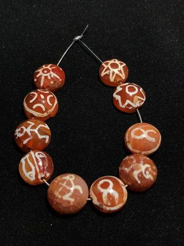 A beautiful 10 pyu ancient beads with motif of animals, figures and fl