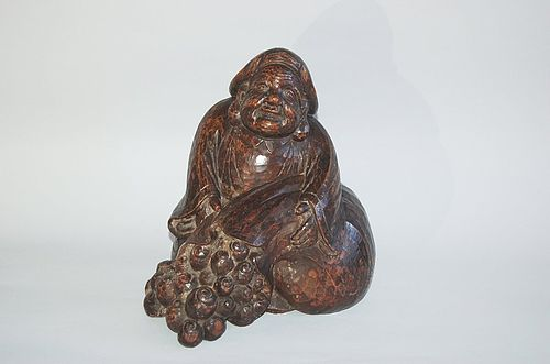 Daikoku with treasure bag, wood sculpture , mingei, Japan 19th c
