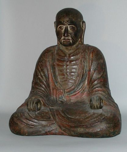 Polychrome wooden sculpture of sitting priest, Japan