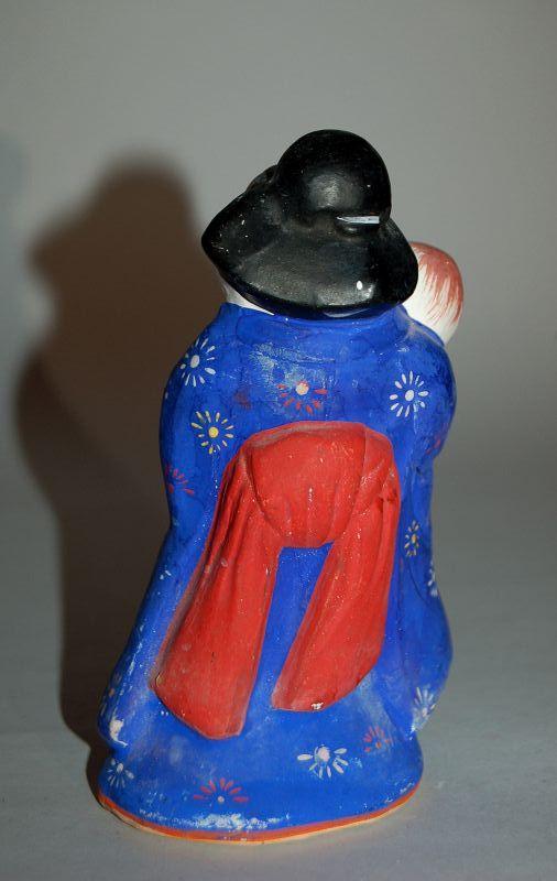 Ceramic erotic statue of Okame with matsudake mushroom, Japan