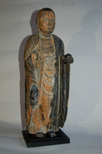 Wooden figure of Jizo bosatsu with jewel, covered in sutras, Japan