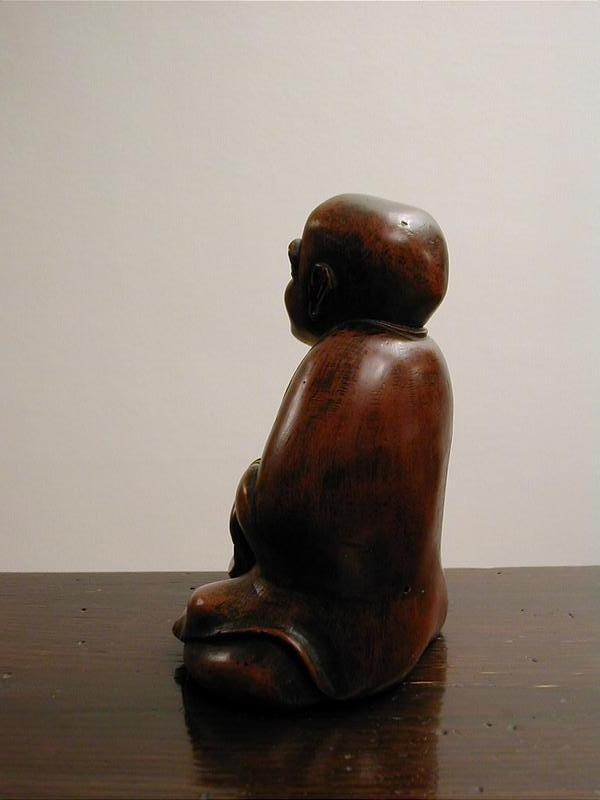 Japanese wooden sculpture of seated man, dated 1823