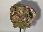 Two architectural pieces, lion heads, Tibet
