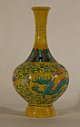 Chinese  ring footed vase in yellow ground with green and aubergine