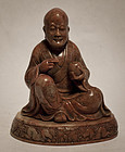 Antique steatite figure of a seated Lohan or Buddha