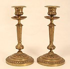 Continental Cast and Chased Bronze Empire Candlesticks